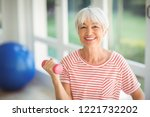 portrait of happy senior woman... | Shutterstock . vector #1221732202