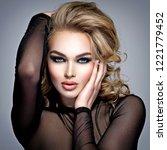 closeup face of a beautiful... | Shutterstock . vector #1221779452