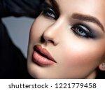 closeup face of a beautiful... | Shutterstock . vector #1221779458
