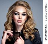 closeup face of a beautiful... | Shutterstock . vector #1221779488