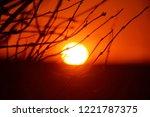 sunset. the departing sun is... | Shutterstock . vector #1221787375