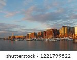 boats and skyline of buildings... | Shutterstock . vector #1221799522