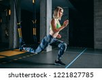 attractive woman doing lunges... | Shutterstock . vector #1221827785