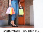 consumerism woman holding many... | Shutterstock . vector #1221834112