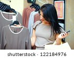 pretty woman shopping in retail store - stock photo