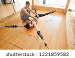 serious qualified yoga... | Shutterstock . vector #1221859582