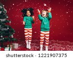 little girls in christmas... | Shutterstock . vector #1221907375
