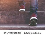 stairway. close up legs jeans... | Shutterstock . vector #1221923182