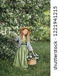 a little girl walks through the ... | Shutterstock . vector #1221941215