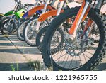 motocross bike stand in a row.... | Shutterstock . vector #1221965755