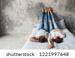 young smiling couple lying on... | Shutterstock . vector #1221997648