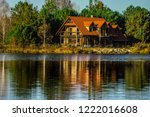 beautiful house reflected in... | Shutterstock . vector #1222016608