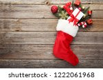 red stocking with fir tree... | Shutterstock . vector #1222061968