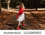cheerful blonde woman walking... | Shutterstock . vector #1222085002