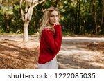attractive blonde woman looking ... | Shutterstock . vector #1222085035