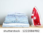 stack of folded clothes with... | Shutterstock . vector #1222086982