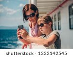 mother and daughter traveling... | Shutterstock . vector #1222142545