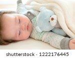 sleepy little baby boy taking a ...   Shutterstock . vector #1222176445