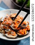 cooking shellfish on a plate | Shutterstock . vector #1222186372