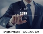 businessman touching year 2019. ... | Shutterstock . vector #1222202125