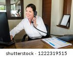 female resort receptionist... | Shutterstock . vector #1222319515