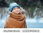 winter portrait of happy young... | Shutterstock . vector #1222342612