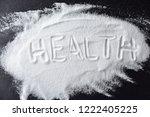 salt shaker with spilled salt.... | Shutterstock . vector #1222405225