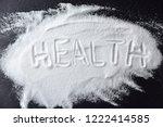 salt spilling from salt shaker. ... | Shutterstock . vector #1222414585