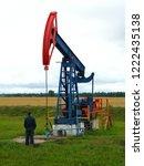 a blue with red oil rig pumps...   Shutterstock . vector #1222435138