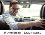 handsome businessman driving a... | Shutterstock . vector #1222446862