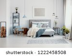 silver painting above bed with...   Shutterstock . vector #1222458508