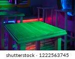 wooden table in dark room with...   Shutterstock . vector #1222563745