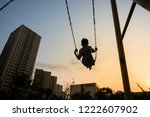 child swinging on swing in... | Shutterstock . vector #1222607902