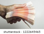 male hand holds a thick stack... | Shutterstock . vector #1222645465