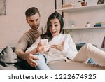 expressive young couple using...   Shutterstock . vector #1222674925