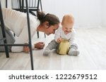 mom and baby playing together... | Shutterstock . vector #1222679512