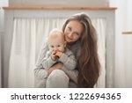 happy mother and baby hugging ... | Shutterstock . vector #1222694365