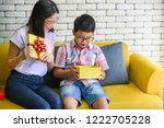 asian boy feeling excited after ... | Shutterstock . vector #1222705228