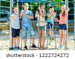 five  glad kids posing  at the... | Shutterstock . vector #1222724272