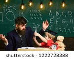 father teaches son elementary...   Shutterstock . vector #1222728388