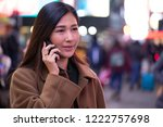 young asian woman in city at... | Shutterstock . vector #1222757698