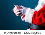santa holding a piggy bank on a ... | Shutterstock . vector #1222786588