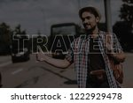 happy young man is hitchhiking. ... | Shutterstock . vector #1222929478