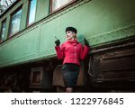 retro woman on the train station | Shutterstock . vector #1222976845