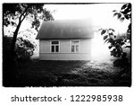 Small Rural Wooden House And...