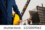 engineer or worker hold yellow... | Shutterstock . vector #1223009062