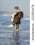 Woman In Formal Dress Riding...