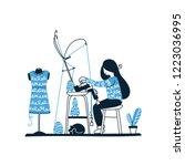 knitter is using knitting... | Shutterstock .eps vector #1223036995