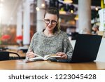 young hipster girl in glasses... | Shutterstock . vector #1223045428