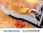 woman after exercises eat... | Shutterstock . vector #1223059858